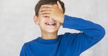smiley-kid-covering-his-eyes_23-2148244793[1]